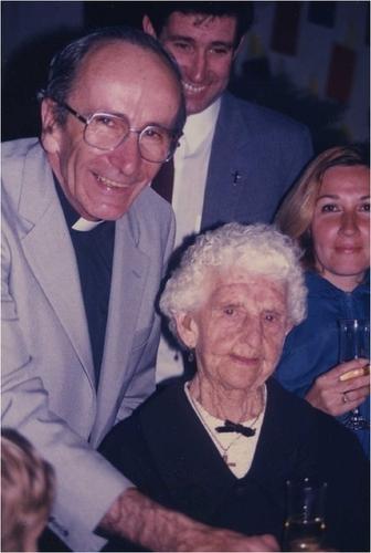 Medium centenary of st. joseph s collingwood  nana stone with archbishop frank little cutting the cake.