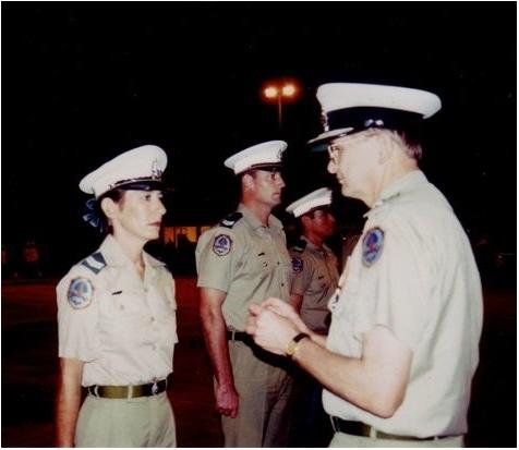 Medium ruth receiving valor medal from commissioner brian bates